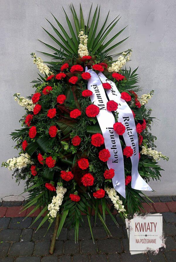 Wieniec pogrzebowy z kwiatów i z szarfą